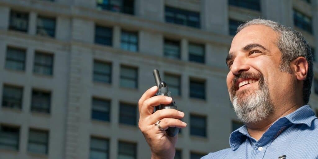 man using walkie talkies